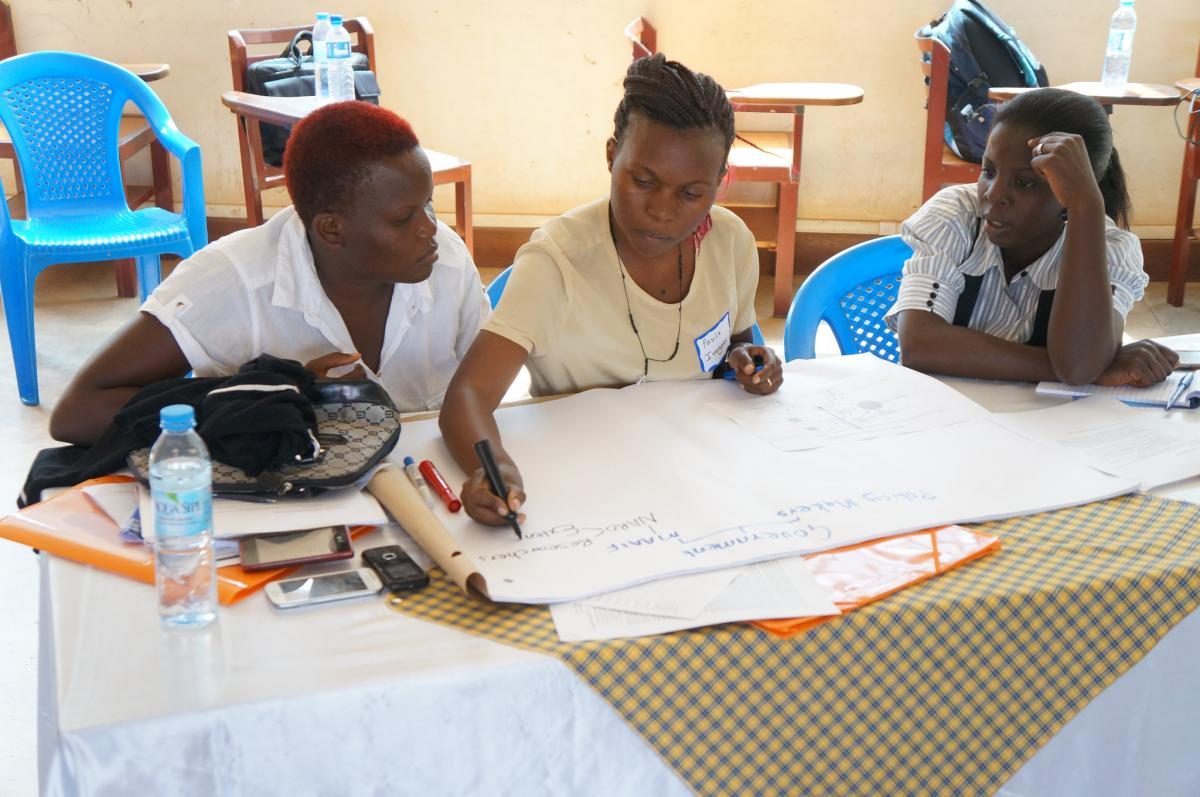 Winifred Candiru, Paula Iragaba, and Ann Ritah Nanyonjo work on an exercise during the July 2015 GREAT pilot course at Makerere University in Kampala, Uganda